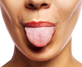 Woman sticking out tongue performing mouthpiece test