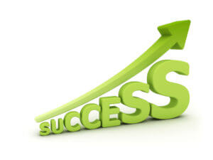 The word success with arrow pointing upward