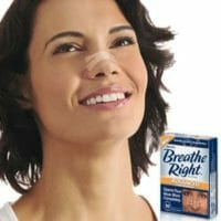Woman wearing Breath right with packaging next to her