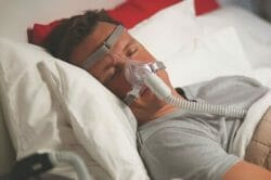 Man wearing CPAP mask sleeping