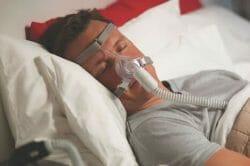 Man wearing CPAP mask sleeping
