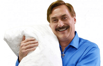 Mike Lindell holding a My Pillow